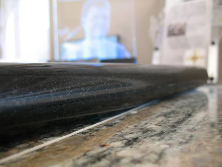 Slabsplash edge on black granite